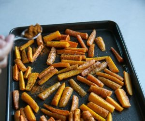 roasted carrots on a baking sheet to make Carrot and nectarine salad