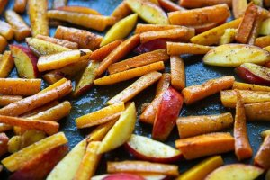 roasted carrots and nectarines on a baking sheet