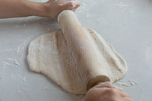 maneesh bread dough being rolled