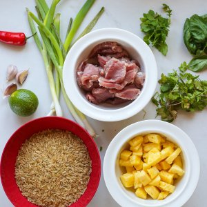 All the ingredients needed to make pork and pineapple stir fry
