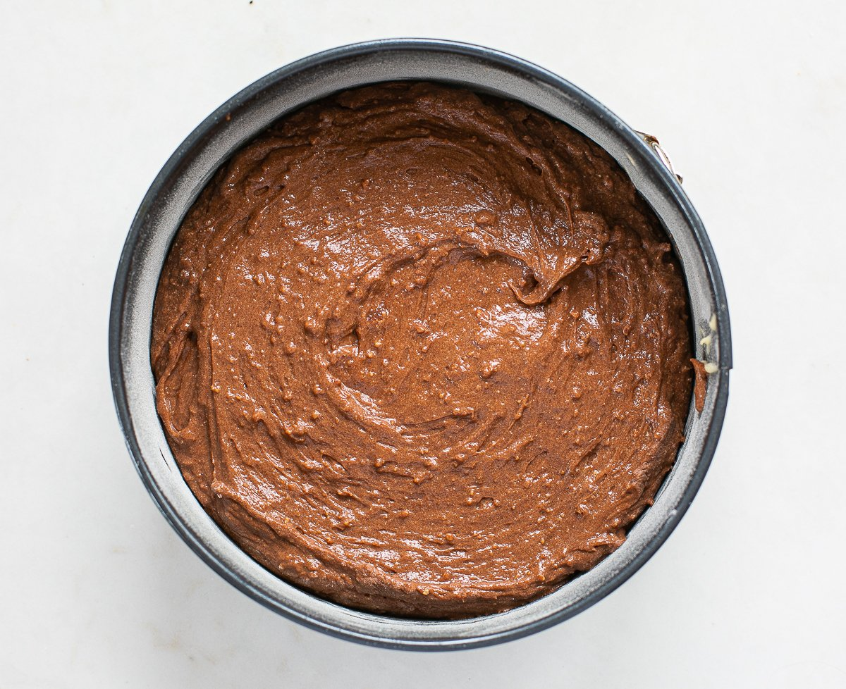 chocolate and amaretti cake mixture in a cake tin
