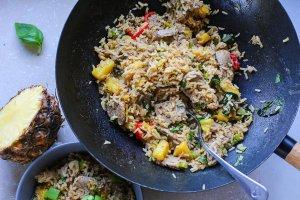 a wok of pork and pineapple stir fry