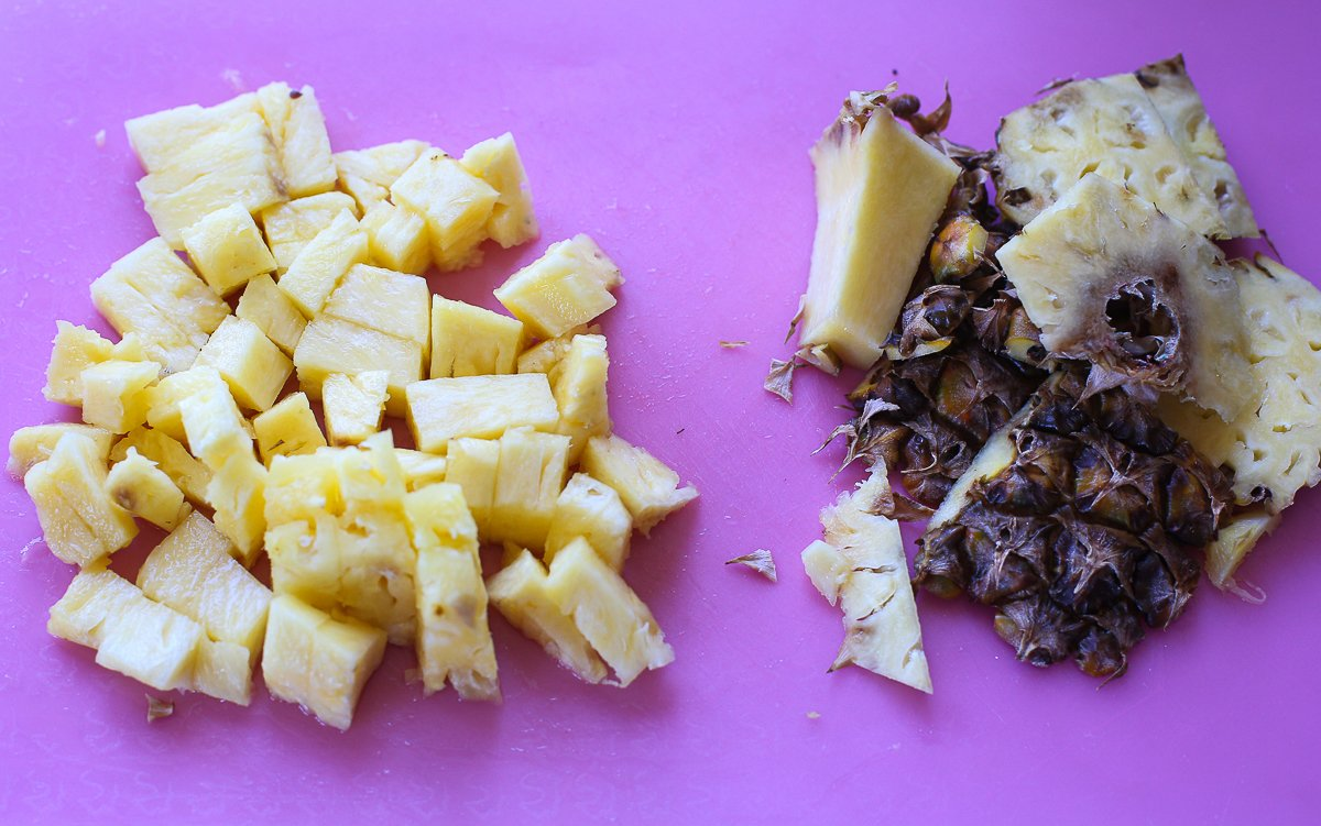 chopped pineapple chunks on a chopping board
