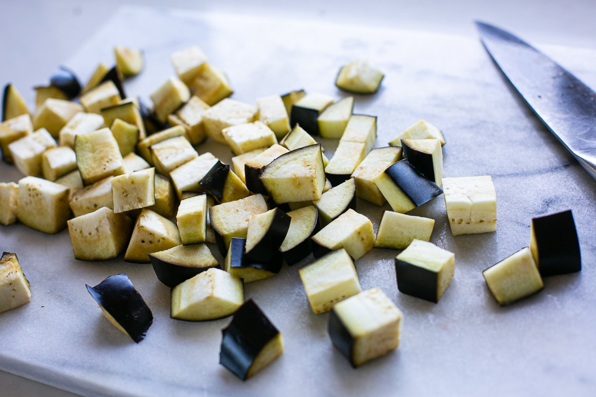 chopped aubergine ready to roast