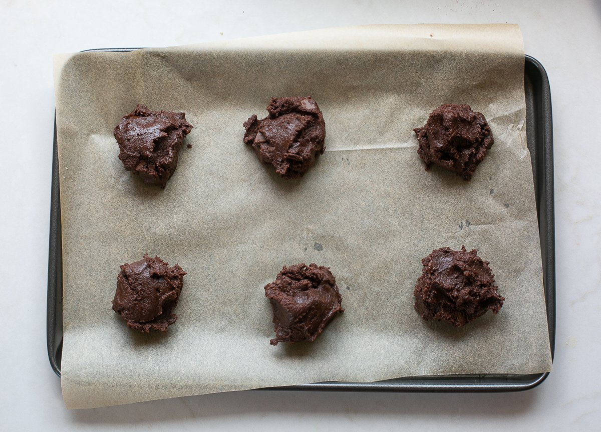 scoops of Double chocolate nutella cookie dough on a baking tray