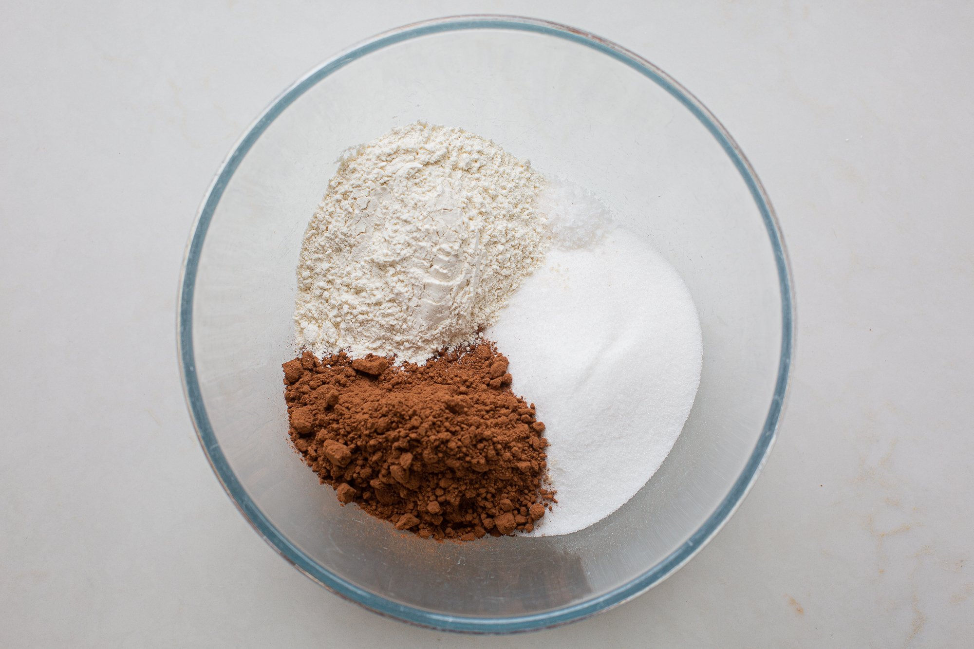 flour cocoa, sugar and salt in a mixing bowl