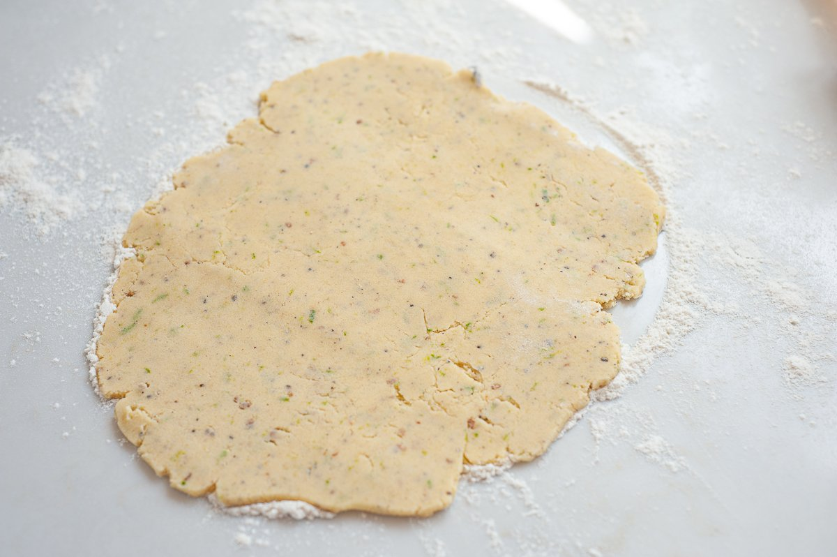 Lime and Cardamom Biscuit dough rolled onto a floured surface