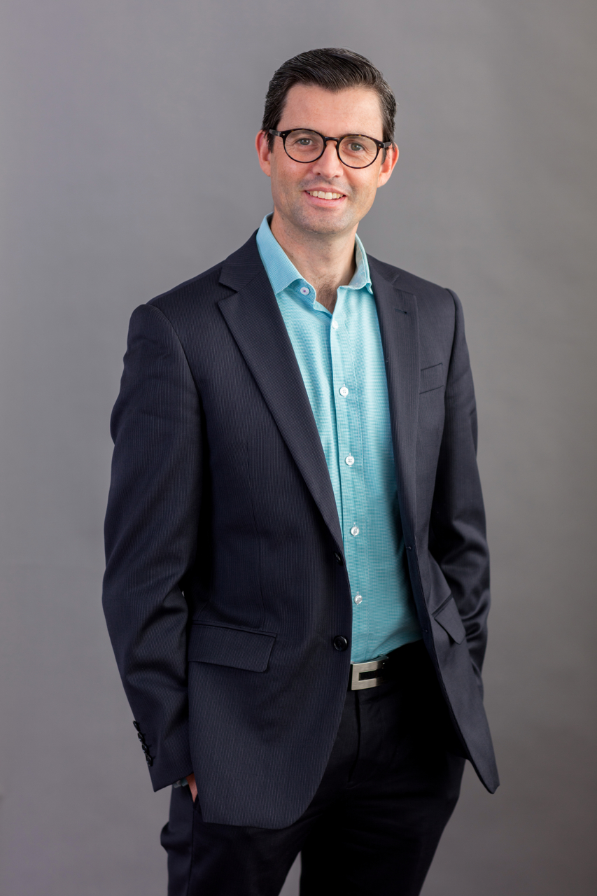 Business headshot on grey background