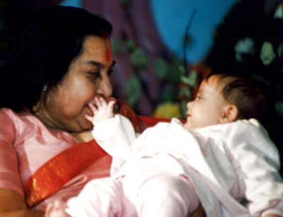 Shri Mataji and a baby