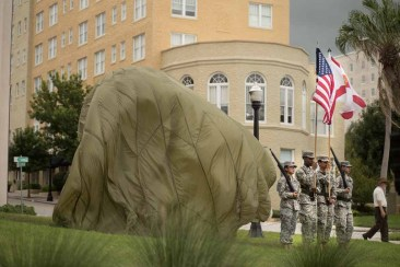 The statue was covered by a parachute prior to the unveiling.