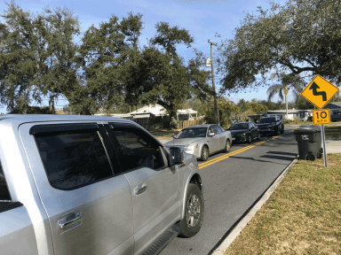An eastbound car turns onto Eastway Drive as westbound cars stack up waiting at the traffic light at South Florida Avenue.