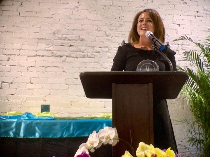 Sarah Powers accepts the Athena Organizational Leadership Award for Top Buttons.