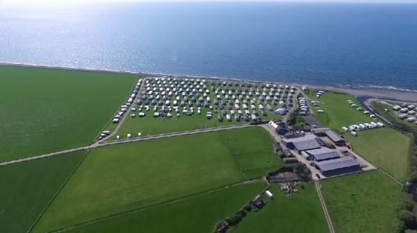 Aerial view of Morfa Caravan Park Llanrhystud on the coastline of Cardigan Bay Wales