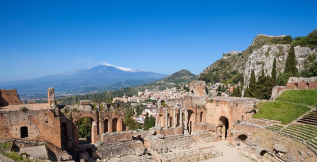 Ancient theatre in Taormina Sicily with Mount Etna