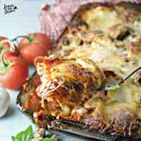 Close up photo of COWBOY LASAGNA @www.loavesanddishes.net being scooped from the plate