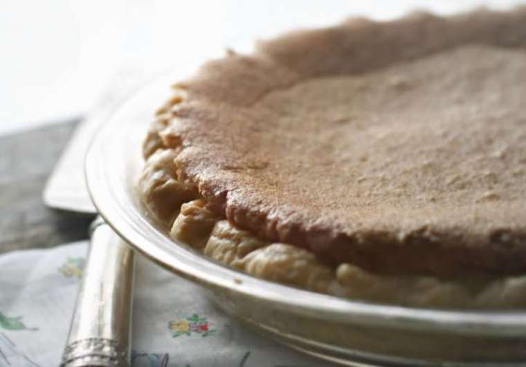 the edge of a chess pie with morning light glistening on the edge.