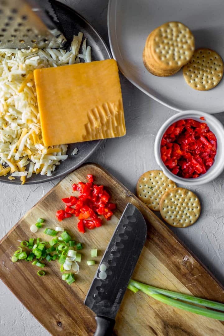 cheese grated, crackers, pimentos and green onion