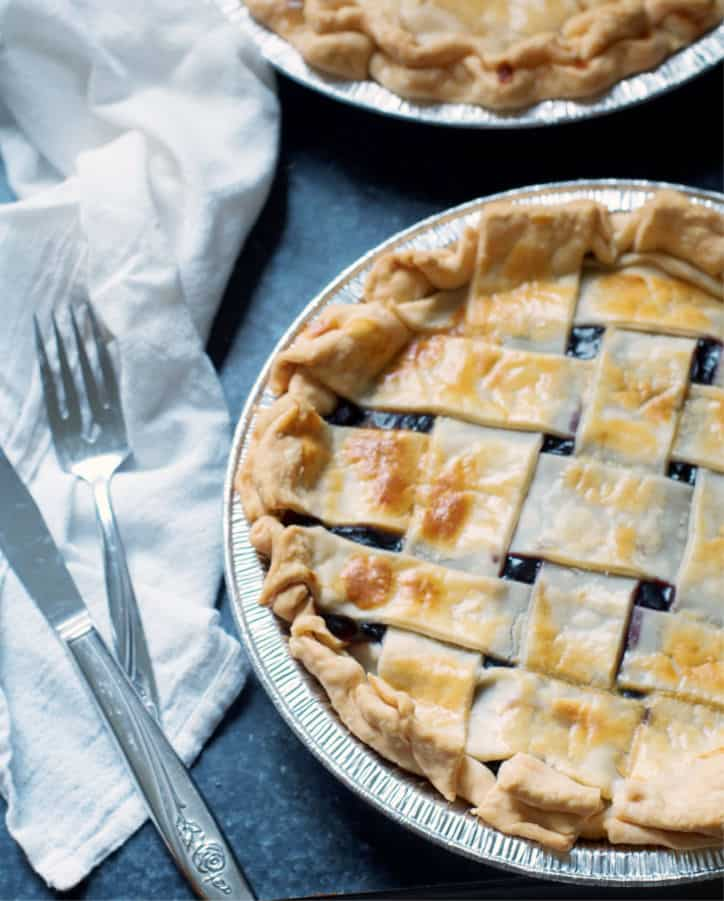 A blueberry pie with a fork for How to Make Blueberry Pie with Blueberry Pie Filling