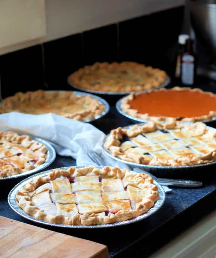 A picture of 6 pies cooling on a countertop
