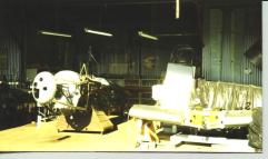 The Fuselage, center-section, wing panels and other restored components, begin to come together for final assembly