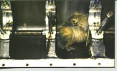 """Foreign material on oil screen after start-up of a professional rebuild disclosed """"left behind"""" shop rag wrapped tightly around accessory shaft"""