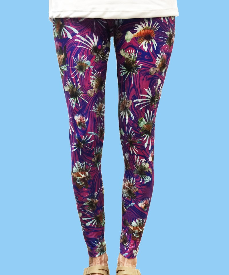 ladies leggings with tropical lionfish with a purple ocean background
