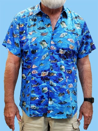Men's dress shirt with many different stingrays all over the shirt with a light blue ocean background