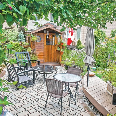 'Princess Diana' clematis frames the entrance to this small back yard perfectly, welcoming people in. The permeable patio helps infiltrate water and keep our creeks clean.