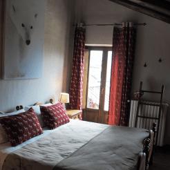 Camera suite con balcone e bagno privato