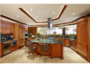Custom kitchen with granite wrap-around counters and beautifully