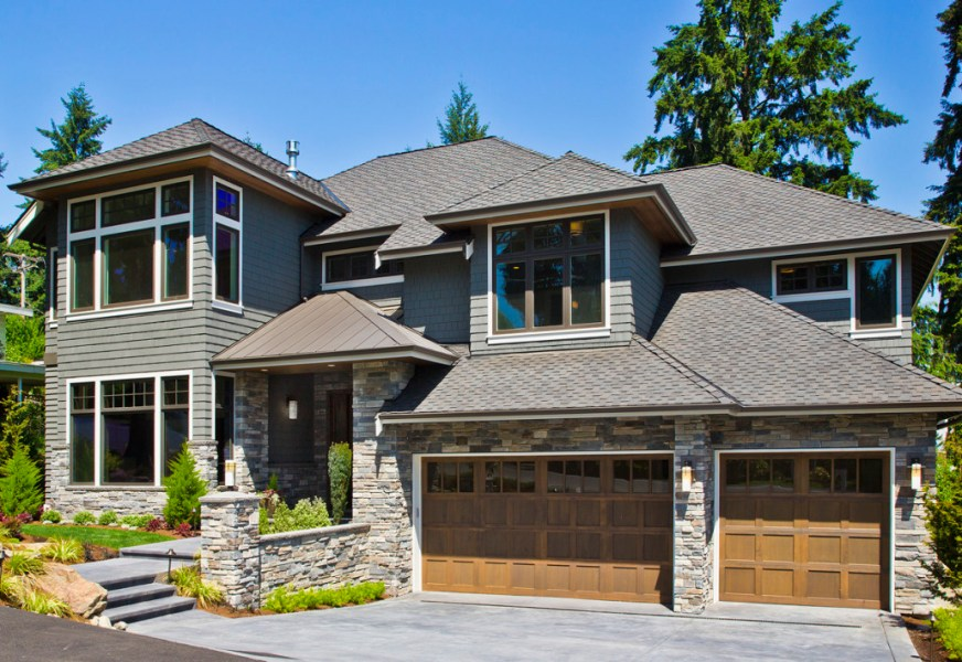 Home Exteriors   Lochwood Lozier Custom Homes  Remodeling and     Lochwood Lozier custom two story home in Bellevue  WA with stone sided