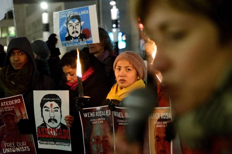 Actievoerders met posters voor nog andere politieke gevangenen in de Filipijnen