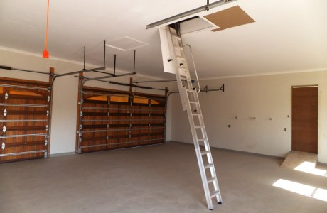 Storage in garage roof accessed by Loft E Ladder