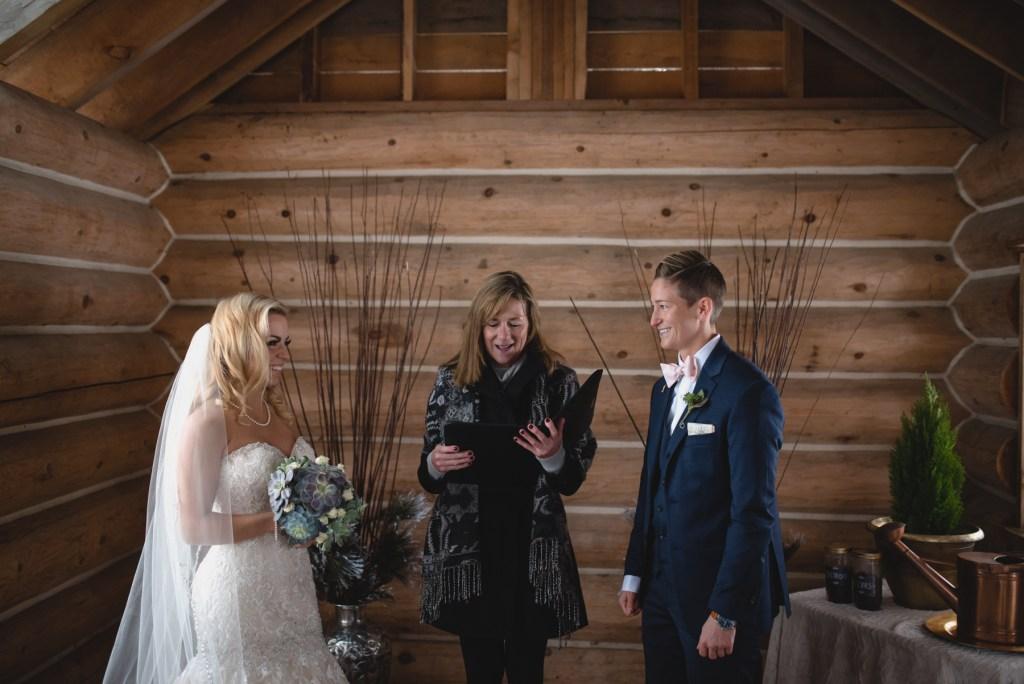 same sex couple log cabin wedding