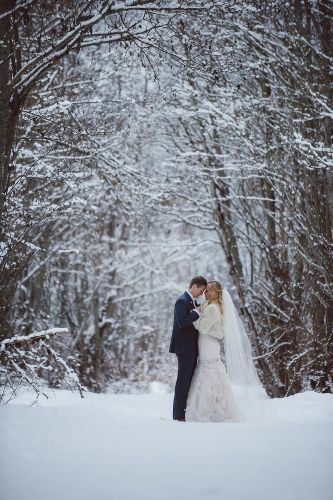 same sex couple scenic in the winter forest