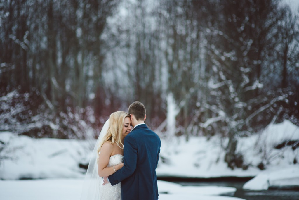 same sex couple embrace on a winter day