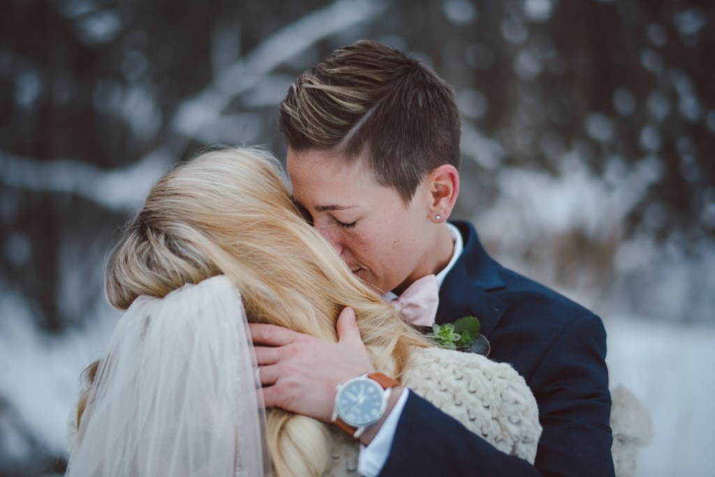 same sex wedding couple embrace