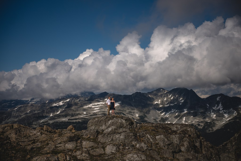An engaged couple with a view of Whistler Blackcomb