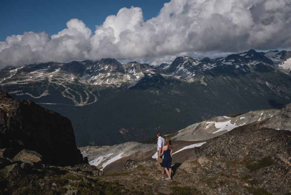 A couple looking at the view of Blackcomb mountain