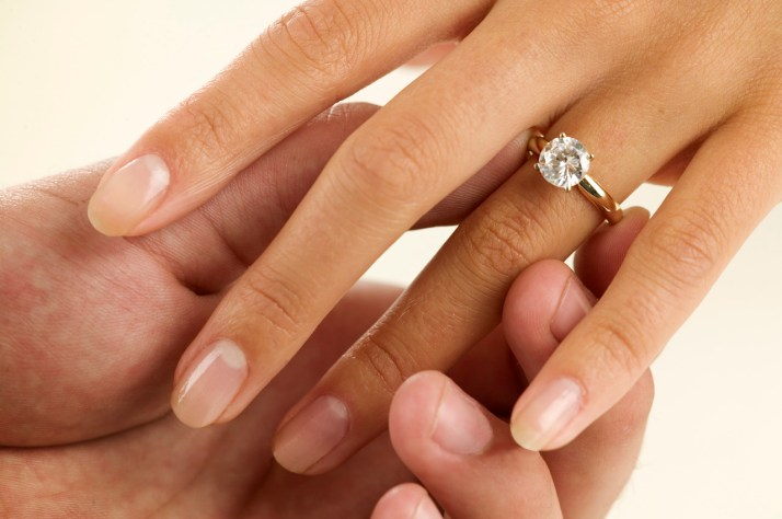 Woman Receiving Engagement Ring
