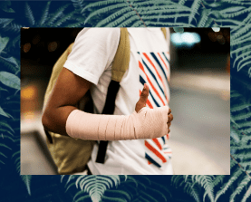 Guy with bandaged wrist carrying a backpack giving a thumbs up