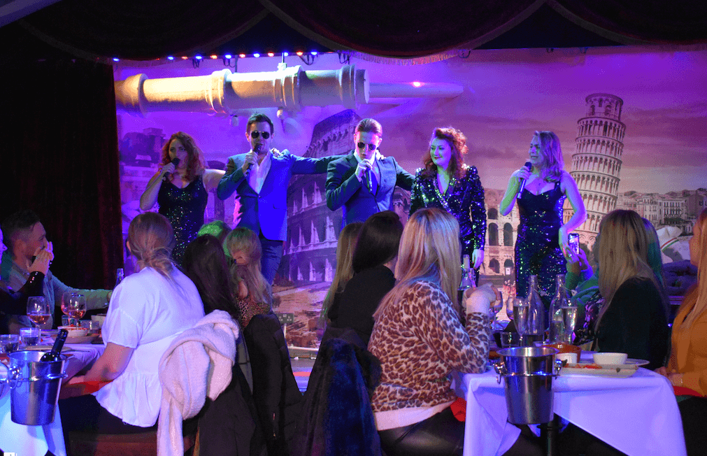 Performers singing at Bunga Bunga, unique restaurant in London
