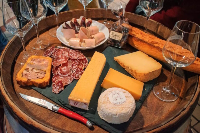Toulouse food tour feast with wine, cheeses, cured meat, chocolates