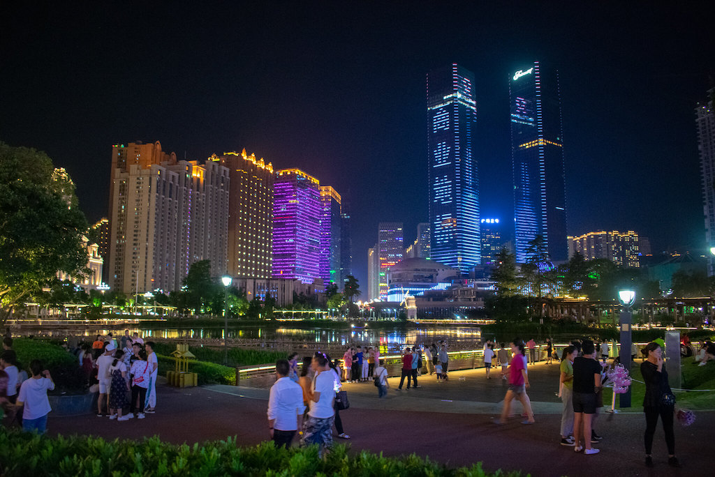 Huanguoyuan in Guiyang China at night with neon lit skyscrapers