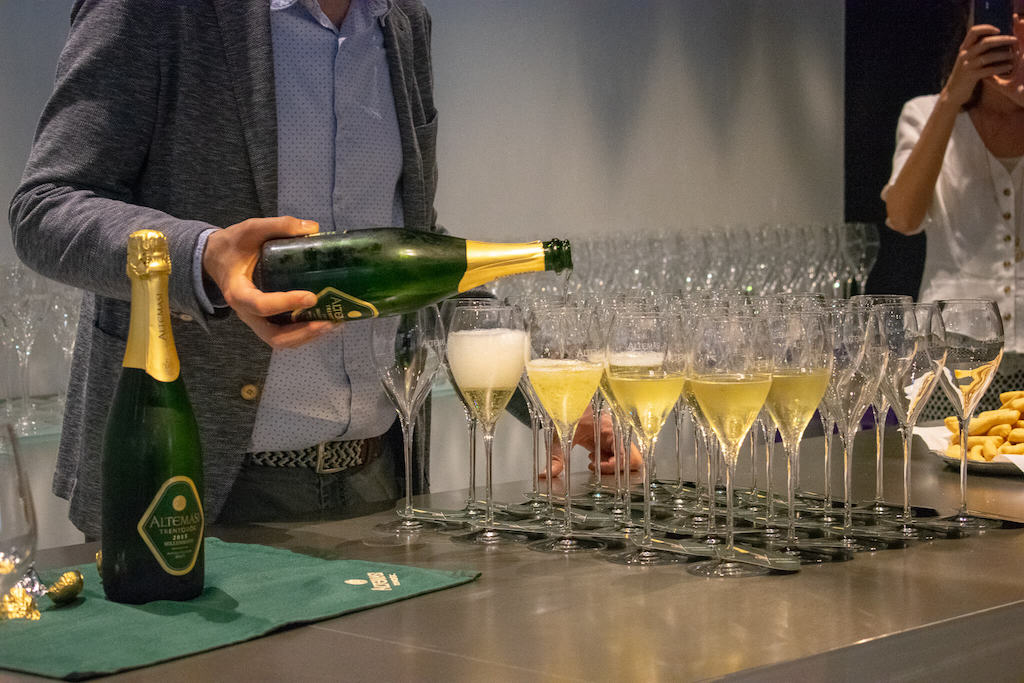 Visit Trentino Italy - man pouring Trentodoc sparkling wine