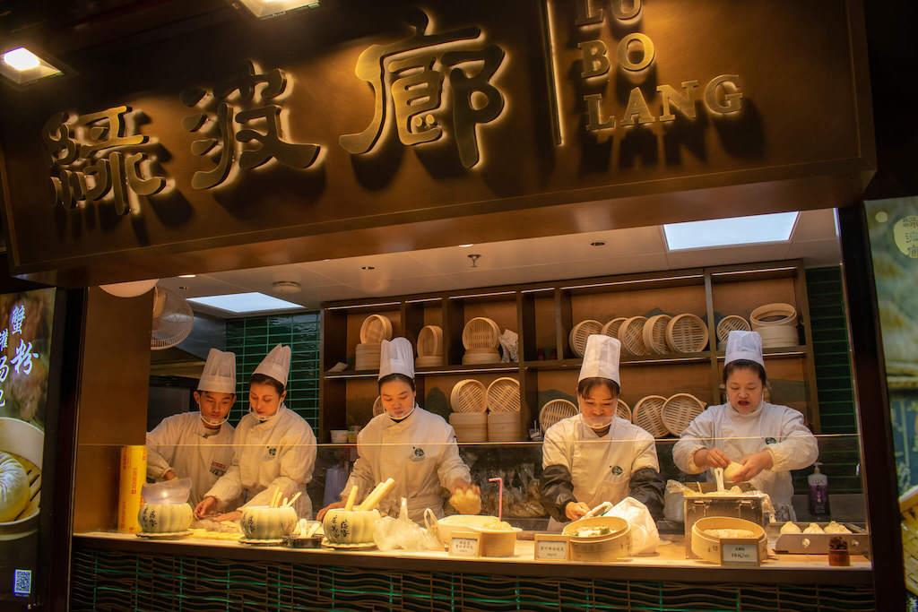 Shanghai Old City, five chefs making soup dumplings in a window
