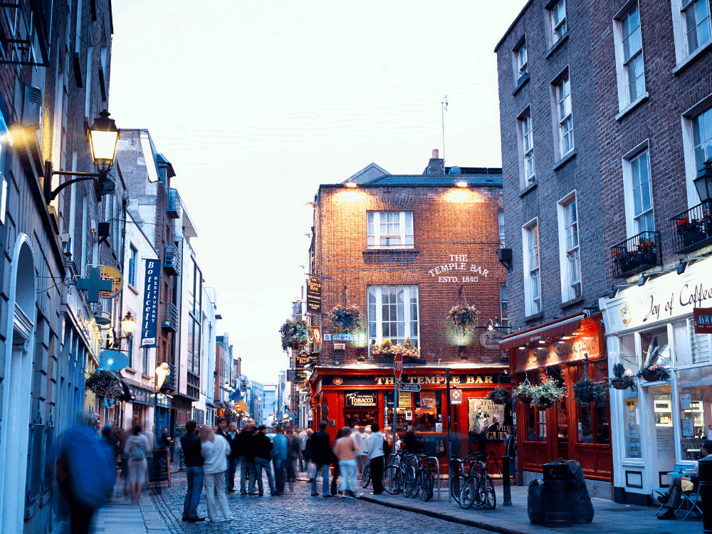Weekend city breaks in the UK, Temple Bar in Dublin with lots of pubs and people in street