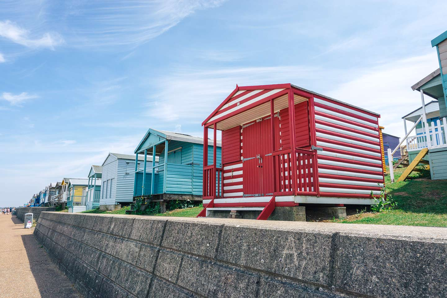 Coastal weekend Trips in the UK, Whitstable colourful beach huts lining the beach