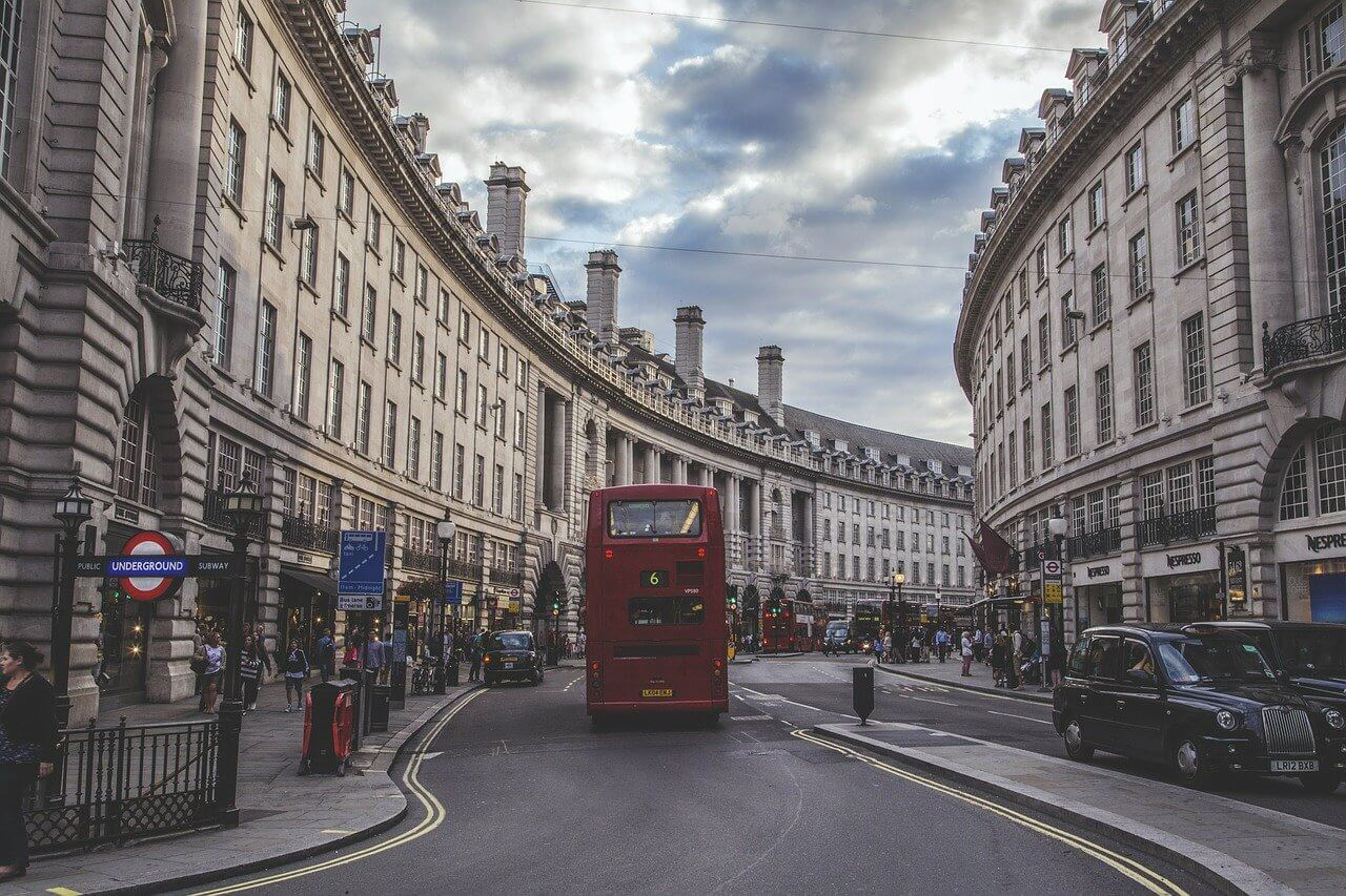 Shoppers and a red bus on Regent Street London