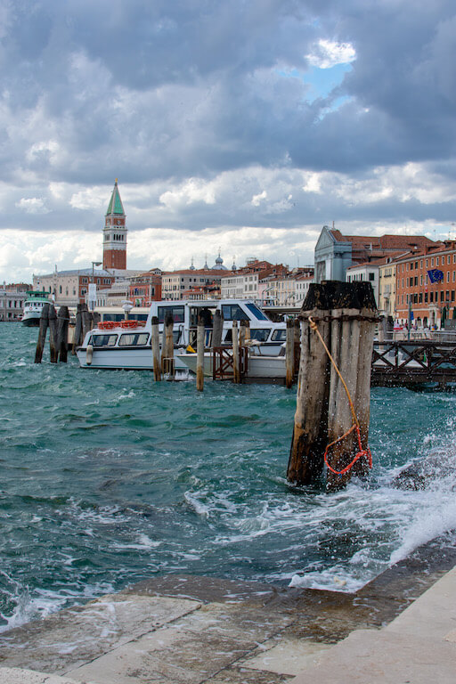 Venice during a storm with grey clouds and flooding walkways